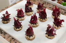 Stuffed pickled hibiscus flower canapes